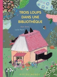 Alain Serres et Lucile Placin - Trois loups dans une bibliothèque.