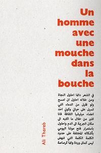 Ali Thareb - Un homme avec une mouche dans la bouche.