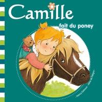 Aline de Pétigny et Nancy Delvaux - Camille fait du poney.