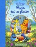 Disney - Winnie est un glouton - Un livre en relief.
