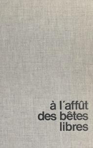 Guy Dhuit et Pierre Pellerin - À l'affût des bêtes libres.