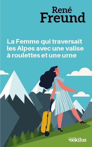 La femme qui traversait les Alpes avec une valise a roulettes et une urne